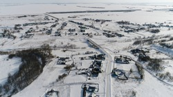 Snow-Covered Russian Village. Aerial View. Quadrotor Filming