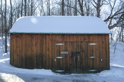 snow covered shack