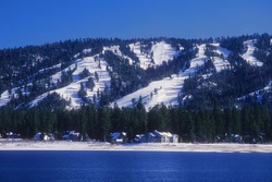 Snow covered ski slopes above the town of Big Bear, California.