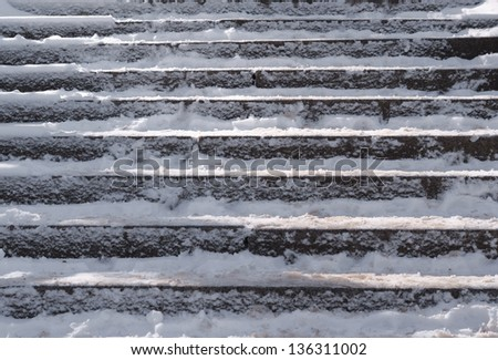 Snow covered slippery stair case abstract winter background composition