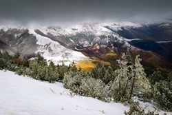 Snow-covered slopes of Sharr Mountains (Šar Planina) in contrast to autumn colors of valleys. Kosovo, Europe.
