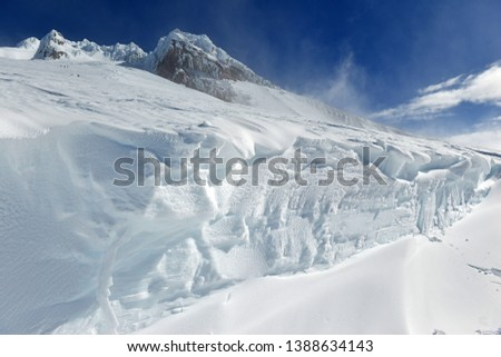 Snow covered terrain on Mount Hood, a volcano in the Cascade Mountains in Oregon popular for hiking, climbing, snowboarding and skiing, despite risks of avalanche, crevasses and weather on the peak. #1388634143