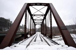 Snow covered train bridge in Montpellier, Vermont