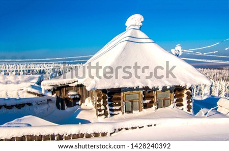 Snow covered village house in winter scene. Snow covered village hut in winter. Winter snow covered village hut. Winter snow covered village hut landscape #1428240392