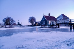 snow covered windmill village in the Zaanse Schans Netherlands, historical wooden windmills in winter Zaanse Schans Holland during winter