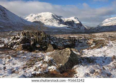 Snow covered Winter landscape in Glencoe in the Scottish Highlands.