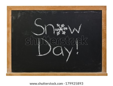 Snow day written in white chalk with a hand drawn snowflake on a black chalkboard isolated on white