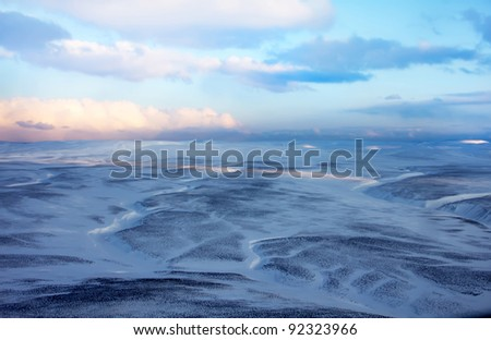 Snow distances of tundra on the East of Russia (Commander Islands) - stock photo