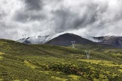 Snow electricity pylons china tibet