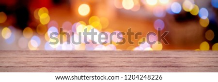Snow falling against defocused of christmas tree lights and fireplace #1204248226