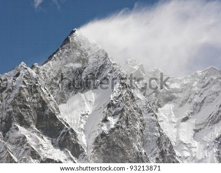 Snow flags on the top of the Lhotse (8516m) - Mt. Everest region