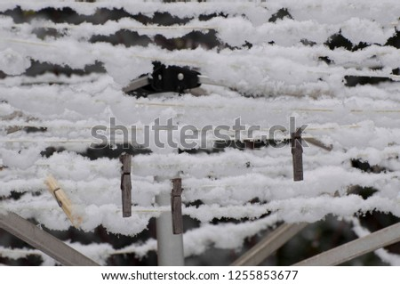 Snow gathers on a clothes line photographed near Shelton, WA, USA.