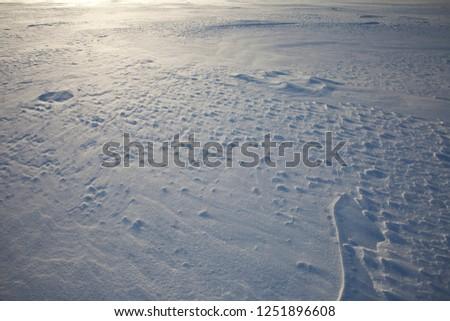 Snow glistens in the sun.