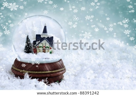 Snow globe with church and christmas trees inside. Copy space available.