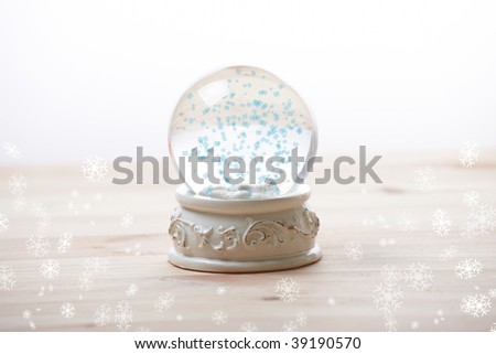 Snow globe with snow flakes, beautiful ornament