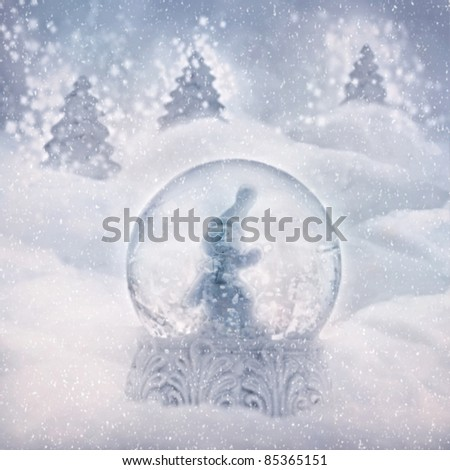 Snow globe with snowman. Winter Christmas background with snow globe