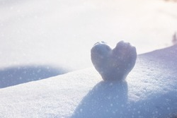 Snow Heart on snowing bench. Winter concept
