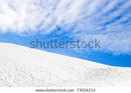 Snow Hill and blue sky with clouds