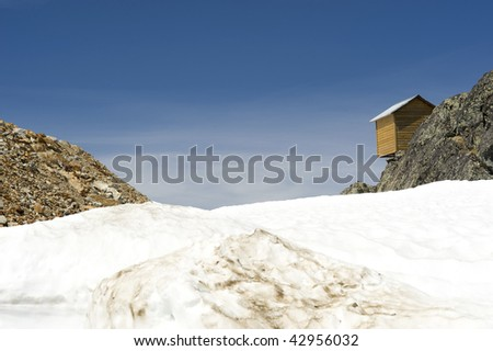 Snow hut against a vacant sky, Whistler, Canada