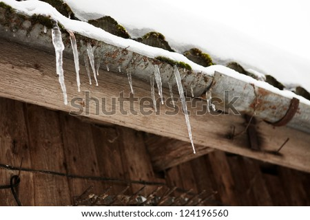 Snow, Icicles and Ice Dam on Roof & Gutter