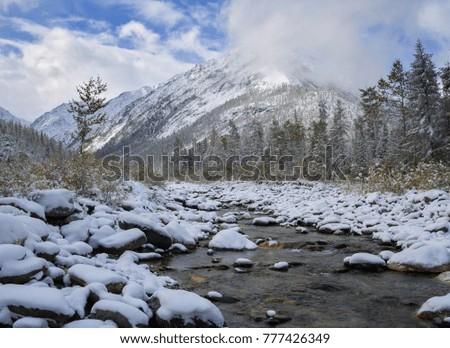 Snow in September in Tunkinskie ridge Eastern Sayan #777426349