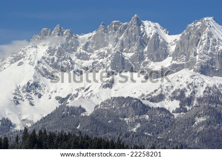 Snow in the Alps - rock landscape
