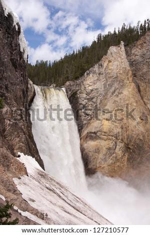 snow melt feeds summer waterfall