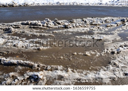 Snow melts and large, dirty puddles form. White snow still lies in some places, and in some places it has already turned into dirt.