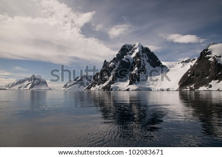 Snow mountain and its reflection in Antarctica