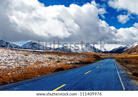 Snow mountain and road