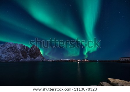 Snow mountain with Aurora in the background/ travel concept world explore northern light