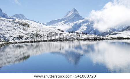 Shutterstock Snow mountains water reflections Swiss Alps in August, Interlaken, Switzerland