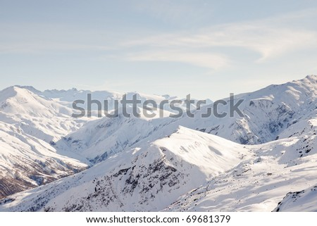Snow mountains with blue cloudy sky