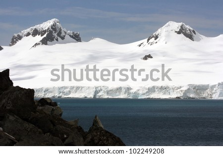 Snow mountans in Antarctica near the water. Beautiful background