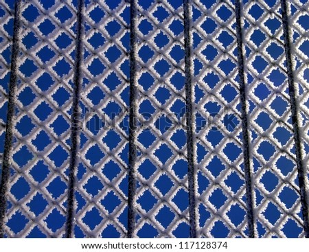 Snow on a gates in the blue sky background, winter time, snow, snowing, winter background, snowy day, winter abstract photo, gates on winter time, gates pattern