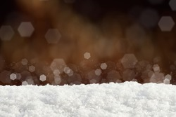 Snow on dark abstract bokeh background