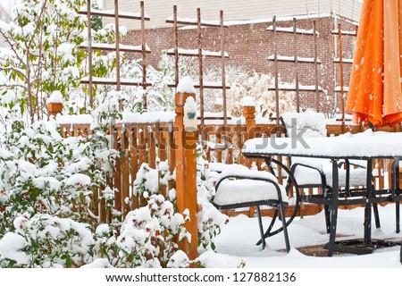 Snow on garden patio, winter scenery
