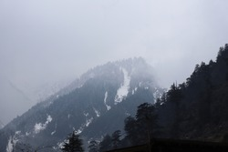Snow on Mountain top with fog prevailing all over at sunrise