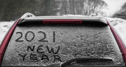 Snow on the car where the numbers are written 2021.  back window of the car. 2021  happy new year