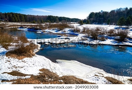Snow on the forest river. Winter river in snow