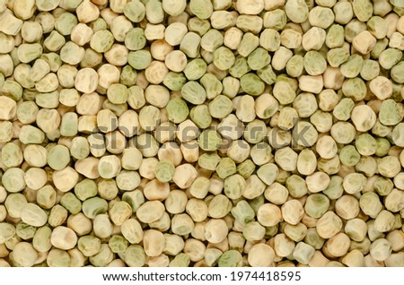 Snow pea seeds, background, from above. Also Chinese pea or pois mangetout, an edible-pod pea with flat pods and thin pod walls. Dried fruits of Pisum sativum used for sprouting. Backdrop. Food photo. Photo stock ©