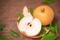 Snow pear or Korean pear on a wooden background, Nashi pear fruits delicious and sweet