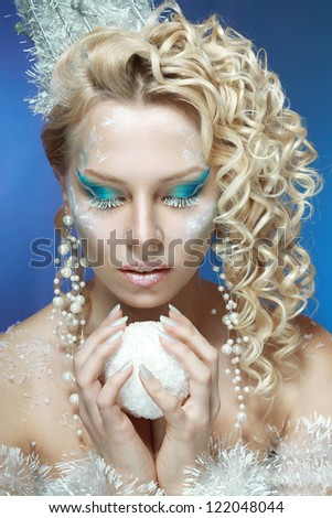 snow-queen. Young woman in creative image with silver blue artistic make-up and perfect hairstyle.