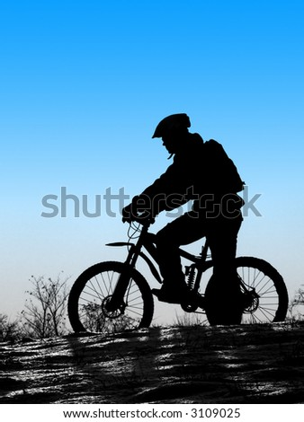 snow rider - mountain biker with clean blue sky