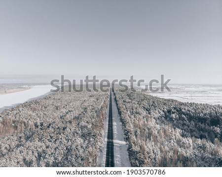snow road in forest. View at road from sky stock photo