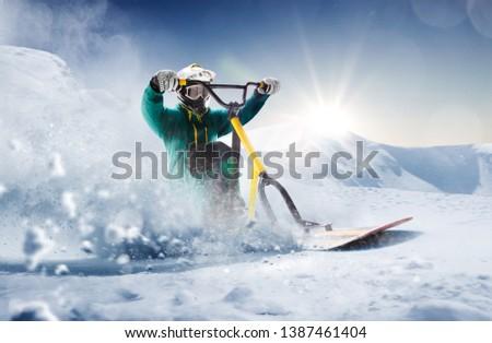 Snow scoot. Snow bike. Extreme winter sports. #1387461404