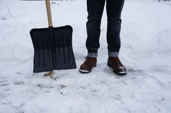 snow shovel cleaning symbol, winter boots and snowdrifts, snow cleaning concept