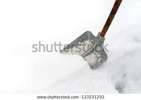 Snow shovel in a deep snow, winter is here