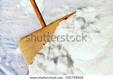 Snow shovel with snow