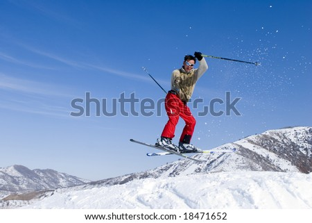 Snow Skier Jumping Against Blue Sky #18471652
